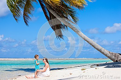 Mother and daughter on tropical beach