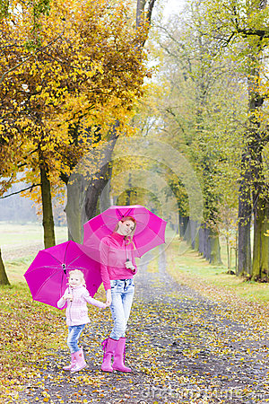 Mother and daughter with umbrellas
