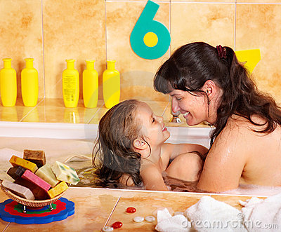 Mother and daughter  washing in bath.