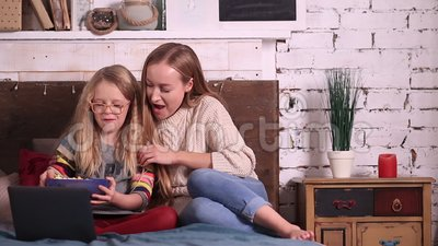 Mother and daughter watching cartoons on laptop stock video footage