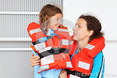 Mother and daughter wearing in life jacket