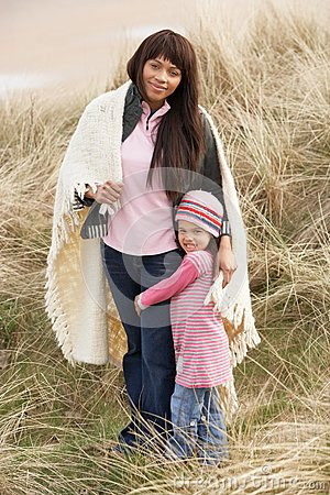 Mother And Daughter Wrapped In Blanket Amongst Dun