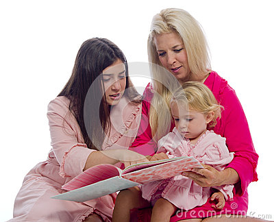 Mother and Daughters Reading  a Book