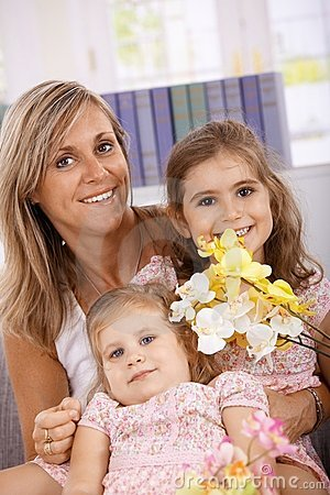 Mother and daughters smiling happily