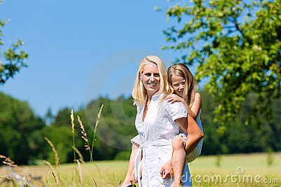 Mother with daugther in meadow