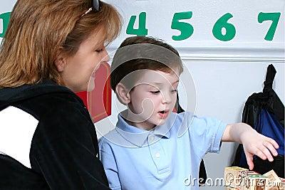 Mother Droping Son Off At Preschool
