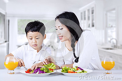 Encourage child to eat salad at home