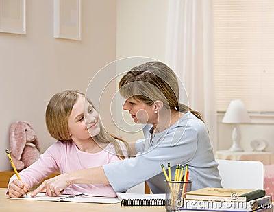 Mother explaining homework to daughter