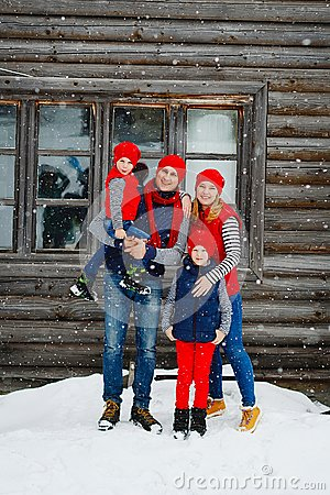 Free Mother, Father And Two Sons Having Fun In Snow Winter Stock Image - 104868801