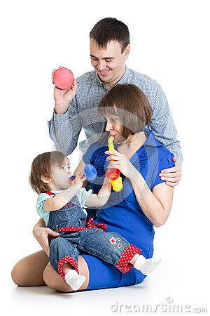 Mother, father and baby girl play musical toys