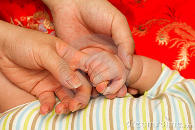 Mother and father and baby hand
