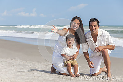 Mother, Father & Boy Child Family Having Fun At Beach