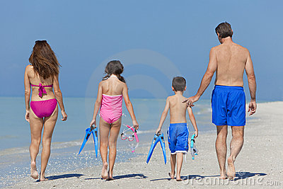 Mother, Father & Children Family Walking on Beach