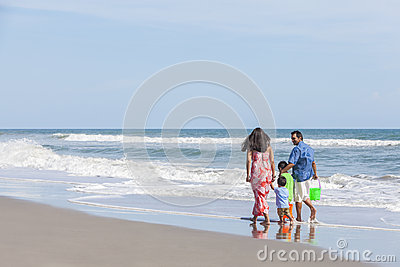 Mother Father & Children Family Walking on Beach