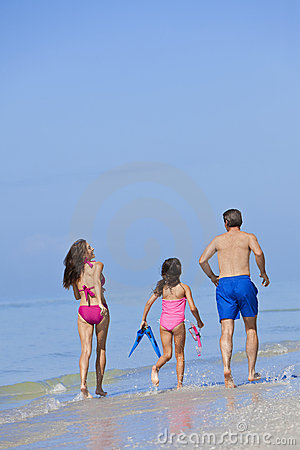 Mother, Father & Daughter Family Running on Beach