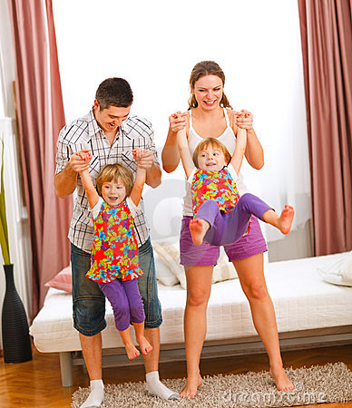Mother and father having fun with twins daughters