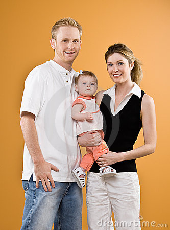 Mother and father holding baby daughter