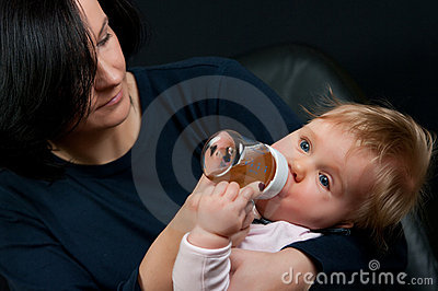 Mother feeding baby with bottle