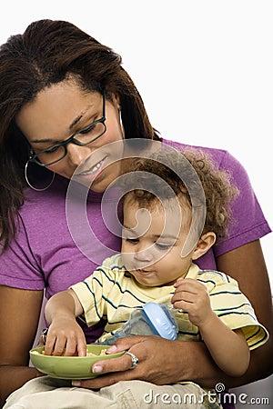 Free Mother Feeding Child. Royalty Free Stock Image - 3422786
