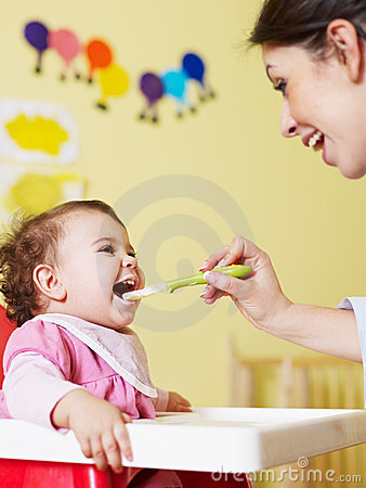 Free Mother Feeding Her Baby Stock Images - 12999484