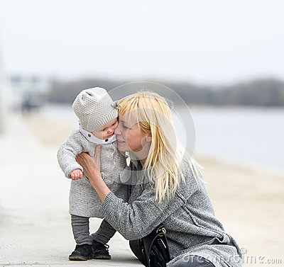 Free Mother Gently Embraces And Kisses The Little Daughter. Stock Images - 71349694