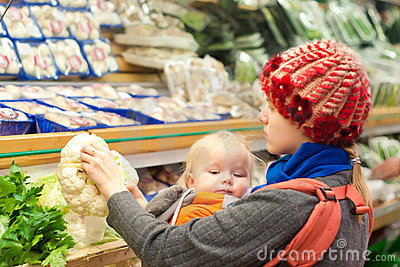 Mother with girl shopping