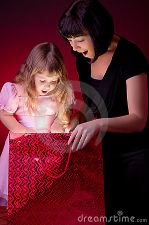 Mother give gift to her daughter