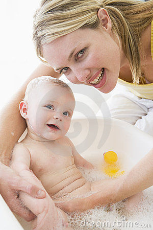 Free Mother Giving Baby Bubble Bath Stock Image - 5940041