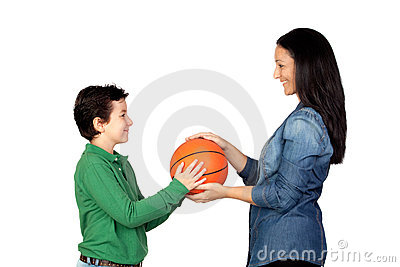 Mother handing a basketball to his son