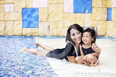 Mother having a quality time at swimming pool