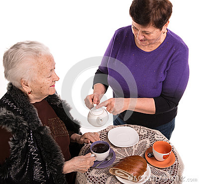 Mother having tea with her daughter