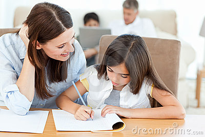 Mother helping her daughter for her homework