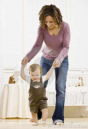 Mother helping son learn to walk