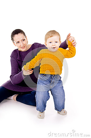 Mother helps to do the first steps of the child