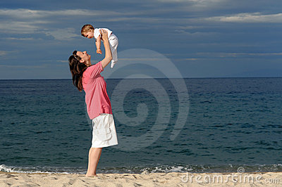 Mother with her baby at beach