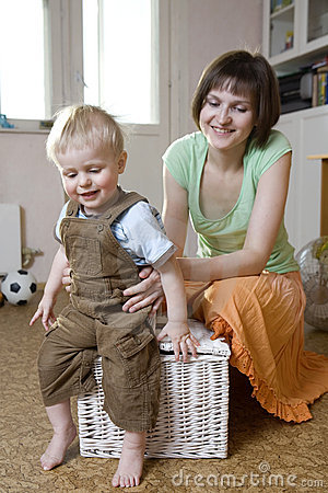 Mother and her blond son have a fun