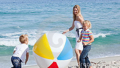 Mother and her children playing with a ball