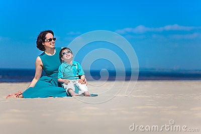 Mother and her cute little son at tropical beach