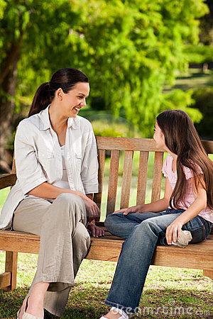 Mother and her daughter on the bench