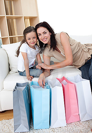Mother and her daughter opening shopping bags