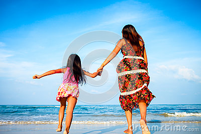 Mother and her daughter running together