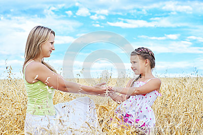 Mother and her daughter at the wheat field