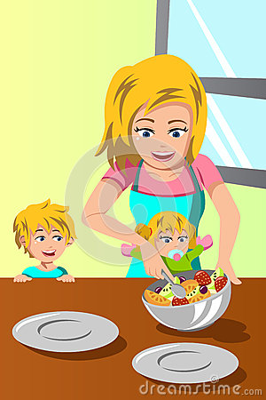 Mother  and her kids preparing salad