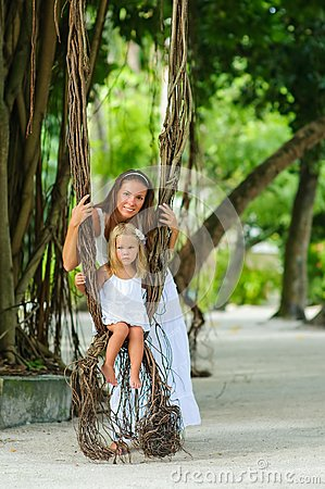 Mother and her little daughter in tropical park