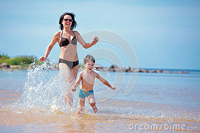 Mother and her little son on the beach