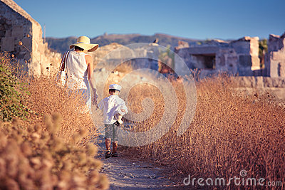 Mother and her little son walking in ancient city