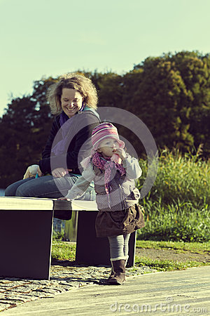 Mother with her young daughter at the park