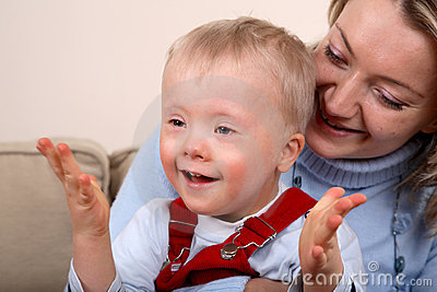 Mother hold handicapped boy