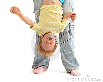 Mother hold her smiling son upside down