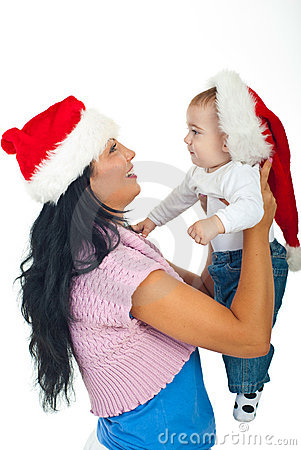 Mother  holding baby at first Christmas